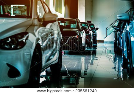 poster of New Luxury Compact Car Parked In Modern Showroom For Sale. Car Dealership Office. Car Retail Shop.