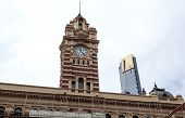 View Of The 1909 Flinders Street Station Clock Tower And The 2006 Eurika Residential Tower In Melbou poster