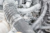 Wash The Engine With Foam. The Engine Is In The Foam For Washing The Car. Hoses In The Foam. poster