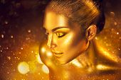 Fashion art Golden skin Woman face portrait closeup. Gold jewellery, jewelry, accessories. Beauty go poster