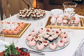Delicious Candy,sweets,cupcakes,pops Decorated With Flowers On Table At Wedding Reception. Candy Bar poster