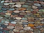 Cut Pebble Stone Texture Wall Floor Colorful Background. Wall Made From Cut Pebble Gravel Stones Dif poster