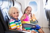 Kids Flying Airplane. Fligh With Children. poster