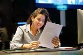Close-up Of Hotel Administrator. A Woman-reception Worker Happy Lady, Enjoying The Good News In Writ poster
