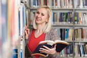 Pretty College Student In A Library poster