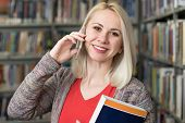 Woman Student Talking On The Phone In Library poster
