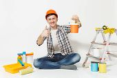 Man In Orange Protective Helmet Sitting On Floor With Paint Can, Instruments For Renovation Apartmen poster
