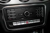 Audio Stereo System, Control Panel And Cd In A Modern Car. Car Control Panel Of Audio Player And Oth poster