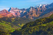 Switzerland, Jungfraujoch, Swiss Alps Autumn Landscape With Colorful Snow White And Pink Rocky Mount poster