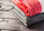 A Stack Of A Warm Woolen Colored Blankets poster