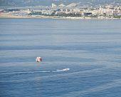 stock photo of parasailing  - Parasailing Adventure At Nice, France popular for tourists