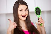 Girl Holds A Hairbrush Without Hair And Smiling poster