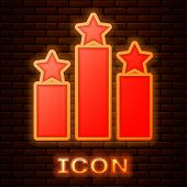 Glowing Neon Ranking Star Icon Isolated On Brick Wall Background. Star Rating System. Favorite, Best poster