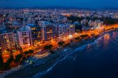 Aerial View Of Limassol Promenade In Cyprus At Night. Drone Photo Of Mediterranean Sea Resort From A poster