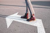 Feet Walking Along The Left Turn Sign. Concept Of Making Correct Decisions, Changing Direction Or At poster