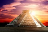 Ancient Mayan pyramid (Kukulcan Temple) on beautiful dramatic sunset sky background, Chichen Itza, Y poster