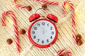 Vintage Red Alarm Clock On White Background. Alarm Clock Shows Five To Midnight. Christmas Sweets, G poster