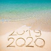 Happy New Year 2020, Lettering On The Beach With Wave And Clear Blue Sea. Numbers 2020 Year On The S poster