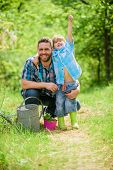 Growing Plants. Take Care Of Plants. Boy And Father In Nature With Watering Can. Spring Garden. Dad  poster