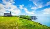 Etretat Village, Church Notre Dame De La Garde Chapel And Aval Cliff. Normandy, France, Europe. poster