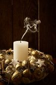 Extinct Candle In A Handmade Gold Wreath-candlestick And Smoke On A Black Background. poster