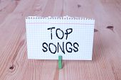 Word Writing Text Top Songs. Business Concept For Recorded Song That Becomes Broadly Popular Or Well poster