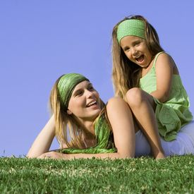 stock photo of mother child  - happy smiling mother and child relaxing outdoors in summer - JPG