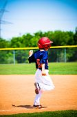 stock photo of little-league  - Youth little league player running to the base - JPG
