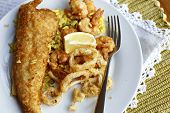 foto of hake  - Grilled Hake and calamari on yellow rice - JPG