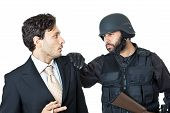 stock photo of corruption  - a corrupted businessman being arrested by a swat agent - JPG