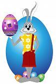 image of buck teeth  - Easter rabbit holds celebratory egg - JPG