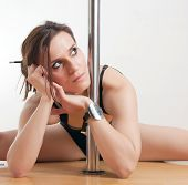 foto of lap dancing  - The young beautiful woman is engaged at a pole - JPG