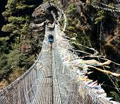 stock photo of nepali  - hanging footbridge ower the dudh koshi nadi river sagarmatha national park  nepal - JPG