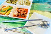 stock photo of kimchi  - Korean cuisine Kimchi on white square dish with spoon and Chopsticks - JPG