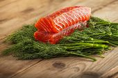 stock photo of lax  - Two pieces of gravlax on the greenery - JPG