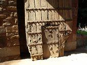 image of tithe  - old wooden door on the Hamayun tomb in New Delhi - JPG