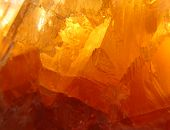 pic of calcite  - Semi transparent orange calcite crystal lighten in the sun - JPG