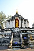 stock photo of gautama buddha  - old thai buddhist pagoda with stand Buddha images in Lamphun Thailand - JPG