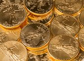 stock photo of mints  - Stacks of gold eagle one troy ounce golden coins from US Treasury mint - JPG