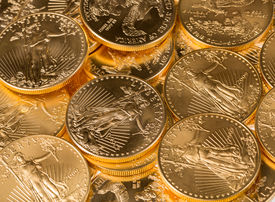 foto of treasury  - Stacks of gold eagle one troy ounce golden coins from US Treasury mint - JPG