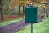 picture of hayfield  - rural autumn scenery at a playground with blank green sign in Southern Germany - JPG