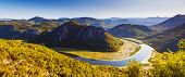 Sinuous river flowing through mountains. Rijeka Crnojevica. Located near Skadar Lake, Montenegro, Eu