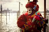 foto of venetian carnival  - Venetian Carnival clown with puppet and gondolas - JPG