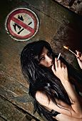 Beautiful Young Girl Lights A Cigarette Near
