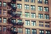 stock photo of brownstone  - Fire escape on an old building in USA - JPG