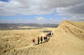 picture of israel people  - Israel National Trail on the edge of Big Crater in Negev desert - JPG