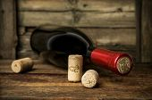 picture of merlot  - bottle of red wine with corks on wooden - JPG
