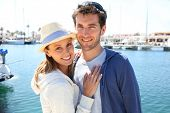 Portrait of cheerful couple ready to get on sailboat for cruising
