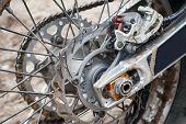 picture of motocross  - Closeup fragment of rear sport motocross bike wheel with brake - JPG