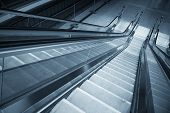 foto of escalator  - Moving escalator in the business center of a city - JPG